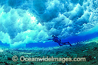 Scuba Diver breaking wave Coral reef photo