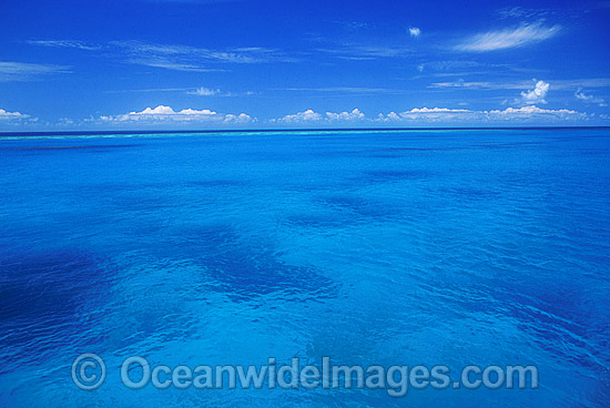 Ocean seascape - island lagoon and sky. Great Barrier Reef, Queensland, Australia Photo - Gary Bell
