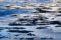 sunset reflection surface photo
