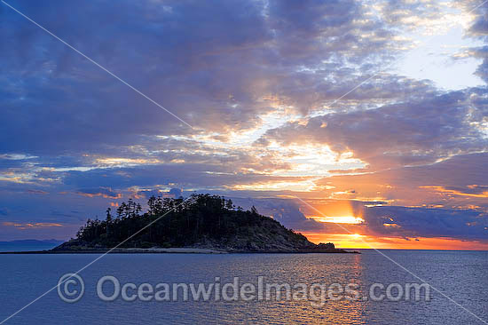 Seascape comprising tropical island and sunset. Whitsunday Islands, Queensland, Australia Photo - Gary Bell