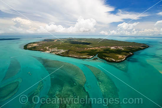 Aerial view of Horn Island, showing settlement and air-strip. Note tidal channels and sea grass beds in foreground. Torres Strait, Queensland, Australia Photo - Gary Bell