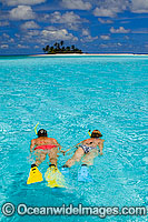 Snorkelers at tropical Island Photo - Gary Bell