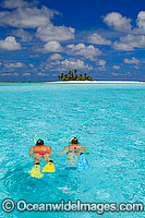 Snorkellers at tropical Island Photo - Gary Bell