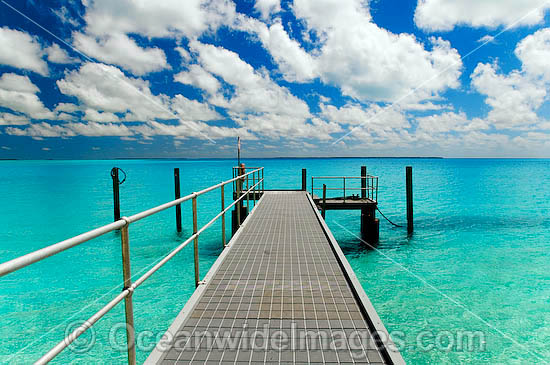 Tropical setting, comprising of jetty, lagoon and sky. Cocos (Keeling) Islands, Indian Ocean, Australia