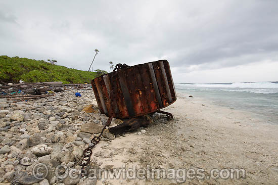 Vagrant mooring block, washed ashore by tidal movement on a remote tropical island beach. Cocos (Keeling) Islands, Indian Ocean, Australia Photo - Inger Vandyke