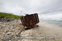 Vagrant mooring block, washed ashore by tidal movement on a remote tropical island beach. Cocos (Keeling) Islands, Indian Ocean, Australia Photo: Inger Vandyke