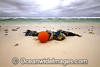 Marine pollution rubbish trash garbage comprising of fishing debris, ropes and floats, washed ashore by tidal movement on a remote tropical island beach. Cocos (Keeling) Islands, Indian Ocean, Australia Photo: Inger Vandyke