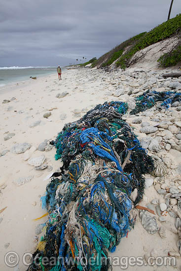 Marine pollution rubbish trash garbage comprising of fishing debris, ropes and nets, washed ashore by tidal movement on a remote tropical island beach. Cocos (Keeling) Islands, Indian Ocean, Australia Photo - Inger Vandyke