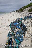 Marine pollution rubbish trash garbage comprising of fishing debris, ropes and nets, washed ashore by tidal movement on a remote tropical island beach. Cocos (Keeling) Islands, Indian Ocean, Australia Photo: Inger Vandyke