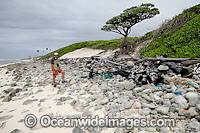 Marine pollution rubbish trash garbage comprising of plastic bottles, footwear and fishing implements, washed ashore by tidal movement on a remote tropical island beach. Cocos (Keeling) Islands, Indian Ocean, Australia Photo: Inger Vandyke