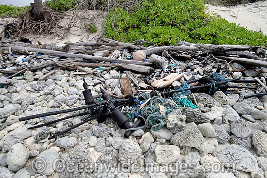 Marine pollution rubbish trash garbage comprising of plastic bottles, footwear and fishing implements, washed ashore by tidal movement on a remote tropical island beach. Cocos (Keeling) Islands, Indian Ocean, Australia Photo - Inger Vandyke