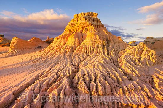 Eroded sand dunes, known as 'Walls of China', during sunset. Mungo World Heritage National Park, New South Wales, Australia Photo - Gary Bell