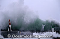 Wave breaking over wall photo