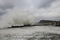 Wave breaking over wall Photo - Chris and Monique Fallows