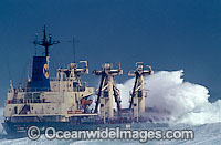 Wave breaking over ship photo