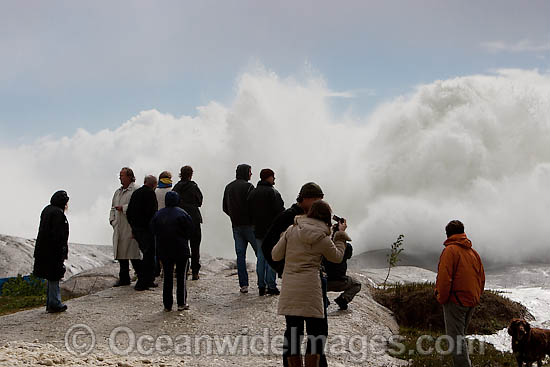 Spectators watch huge wave break on shore during a storm. Cape Town, South Africa Photo - Chris and Monique Fallows