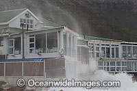 Wave breaking over house