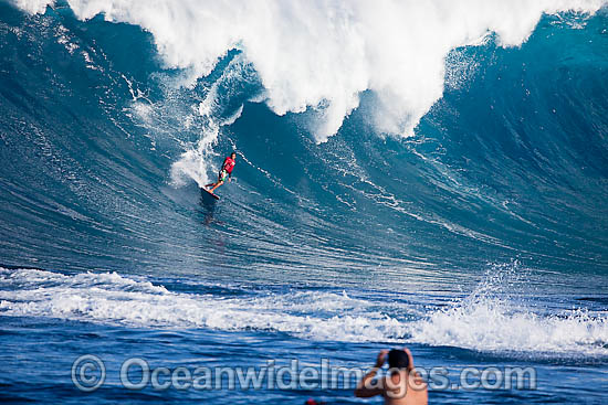 A tow-in surfer drops down the face of Hawaii's big surf at Peahi (Jaws) off Maui, Hawaii, Pacific Ocean. Photo - David Fleetham