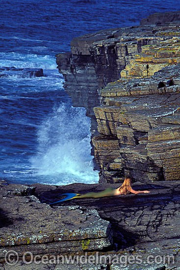 This ocean scene with a Mermaid (MR) resting on a rock platform is a composite image, comprising of 2 or more images digitally merged together.