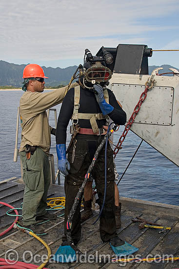 A commercial hard hat Diver (MR) prepares for a dive, Oahu, Hawaii, USA.