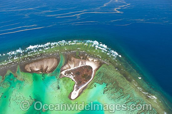 Red Tide drifting close to One Tree Island reef, located near the Tropic of Capricorn in the southern Great Barrier Reef, Australia. Red Tide is a common name given to algal bloom of toxic, naturally occurring microscopic plankton known as Dinoflagelates.