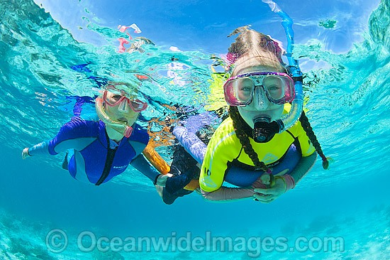 Children with parent snorkel diving on the Great Barrier Reef. Photo taken at Heron Island, Great Barrier Reef, Queensland, Australia. Photo - Gary Bell