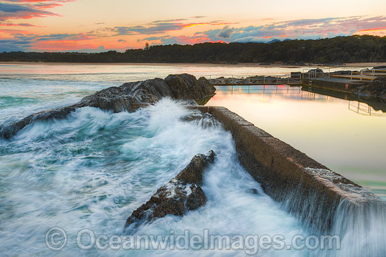 Sawtell Rock Pool at sunset. A favourite natural rock swimming pool open to the general public. Sawtell, New South Wales, Australia. Photo - Gary Bell