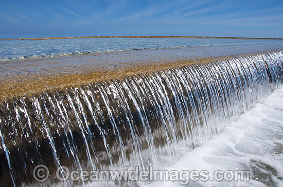 Sea water running over a tidal sea wall. Heron Island, Great Barrier Reef, Queensland, Australia. Photo - Gary Bell