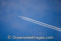 Jet stream in sky Photo - Gary Bell