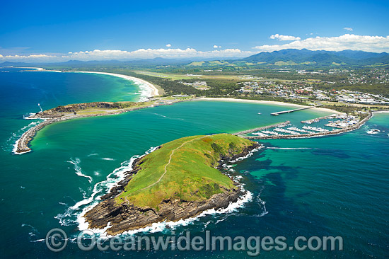 Aerial view of Coffs Harbour, situated on the northern New South Wales coast, showing Mutton Bird Island, protected boat harbour with jetty, Coffs Harbour township and mountain range. Coffs Harbour, Australia. Photo - Gary Bell
