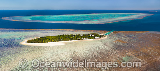 Aerial view of Heron Island and reef, showing Wistari Reef in distance. Heron Island is a small coral cay located near the Tropic of Capricorn in the southern Great Barrier Reef, Australia, and part of the Capricorn group of Islands. Photo - Gary Bell