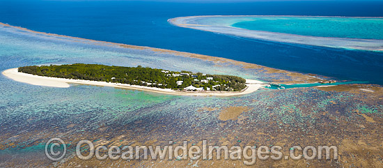 Aerial view of Heron Island and reef, showing Wistari Reef at the right. Heron Island is a small coral cay located near the Tropic of Capricorn in the southern Great Barrier Reef, Australia, and part of the Capricorn group of Islands. Photo - Gary Bell