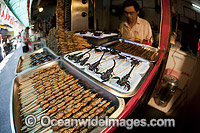 Deep fried Insects on a Stick Photo - David Fleetham