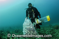 Scuba Diver with garbage photo