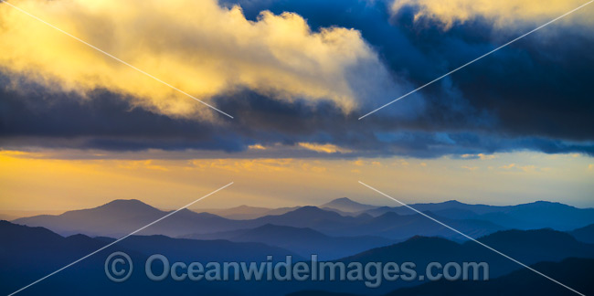 Panorama view of mountains and sunrays at morning sunrise from Point Lookout, on the Great Escarpment situated in Gondwana Rainforest, New England National Park, New South Wales, Australia. Photo - Gary Bell