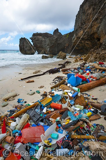 Marine pollution, rubbish trash, garbage comprising of plastic bottles and footwear washed ashore by tidal movement on a remote Christmas Island beach, Indian Ocean, Australia. Drifted from Indonesia. Photo - Gary Bell