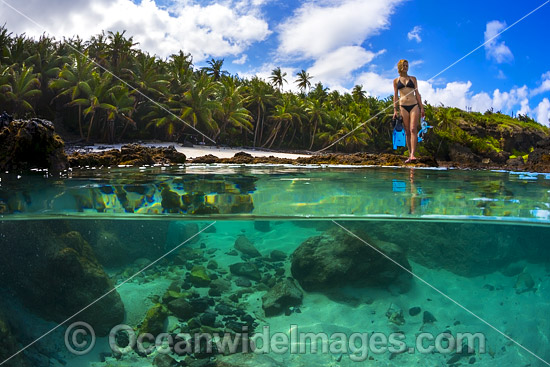 Snorkel diver exploring a tidal rock pool at Christmas Island, Indian Ocean, Australia. Photo - Gary Bell
