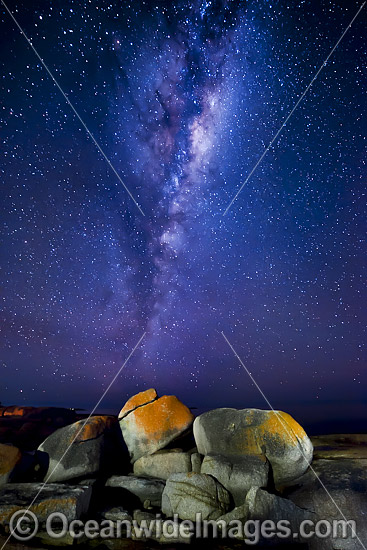 The Milky Way pictured over lichen covered granite boulders, situated on the Granite Coast. Bicheno, Tasmania, Australia. Photo - Gary Bell