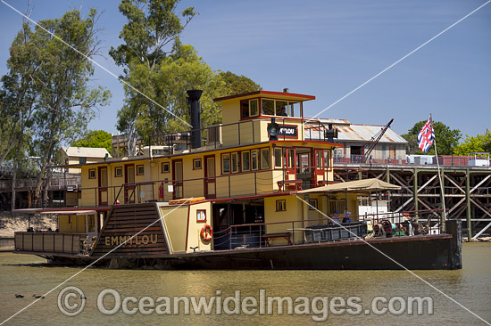 Historic wood fired paddlesteamer, PS Emmylou, cruising down the Murray River at Echuca with historic wharf in background, Victoria, Australia. Photo - Gary Bell