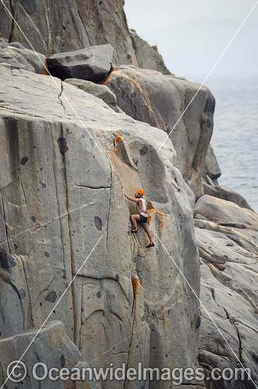 Rock climber, climbing White Water Wall, located in Freycinet National Park, Tasmania, Australia. Photo - Gary Bell