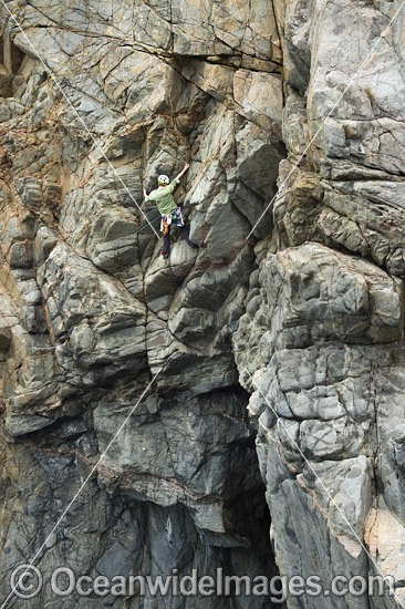 Rock climber, climbing Beowulf Wall, located in Freycinet National Park, Tasmania, Australia. Photo - Gary Bell