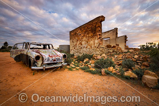Abandoned old car beside the historic remnants of a Miners Cottage in the outback town of Silverton, near Broken Hill, New South Wales, Australia. Photo - Gary Bell