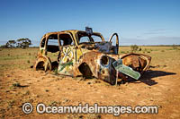Old car riddled in bullet holes Photo - Gary Bell