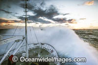Wave breaking over ship Antarctica photo