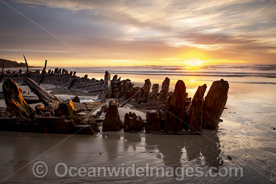 Historic Shipwreck 'Buster' on Woolgoolga beach, New South Wales. Vessel was blown ashore & beached during a violent storm in Feb 1893. Class: Barquentine. Construction: Timber single deck & 3 masts. Built: Nova Scotia, Canada 1884. Length - 129 ft. Photo - Gary Bell