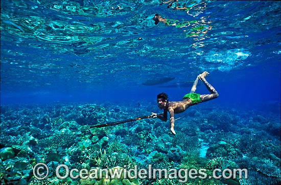 Village Spearfisherman hunting with hand-made speargun. Sumba, Indonesia Photo - Gary Bell