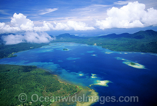 Aerial view of fringing coastal reefs. Kimbe Bay, New Britain Island, Papua New Guinea Photo - Gary Bell