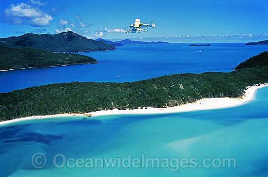 Aerial view of Whitsunday Island beach and Great Barrier Reef excursion float plane. Whitsunday Islands, Queensland, Australia Photo - Gary Bell