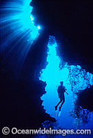 Silhouette Scuba Diver exploring cave photo