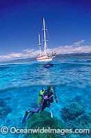 Scuba Diver beneath sailing yacht Photo - Gary Bell